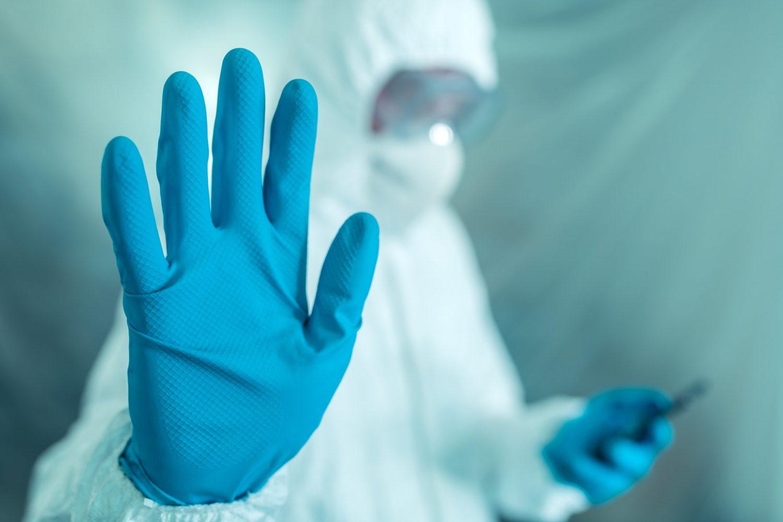 epidemiologist-gesturing-stop-hand-sign-in-coronavirus-concept-e1580463160776